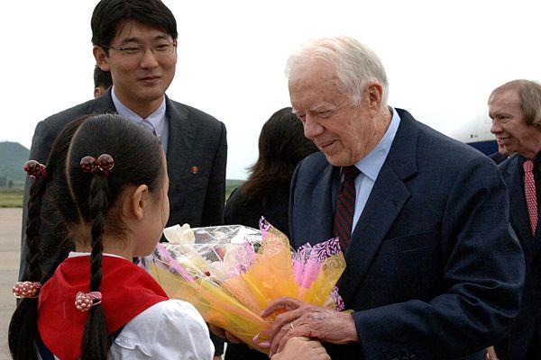 <em>Former President Carter Arrives in Pyongyang to Negotiate Release of American Prisoner.</em>