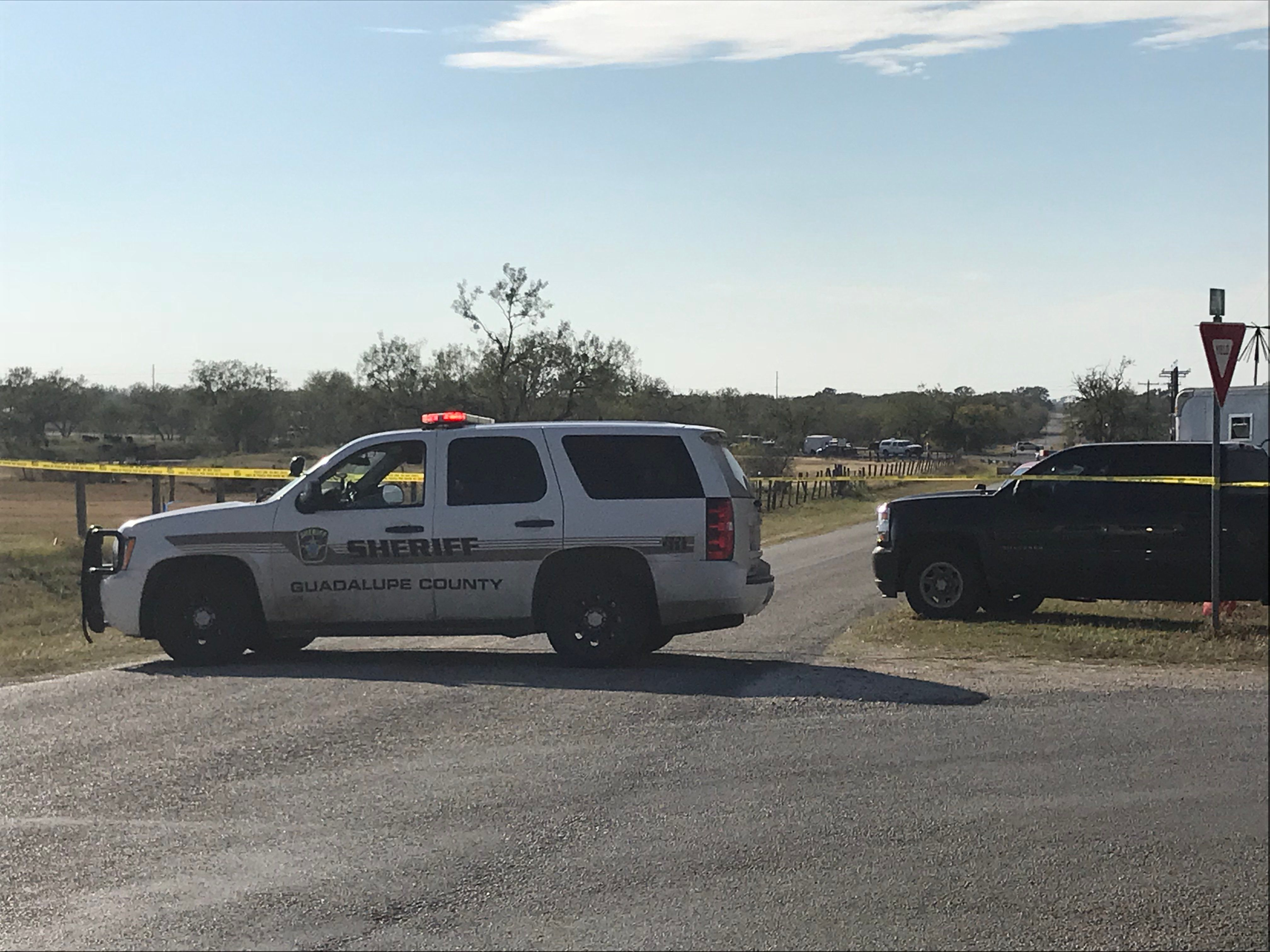 Police block a road in Sutherland Springs, Texas, after a gunman shot dozens of people at a nearby church...