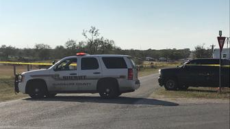 Police block a road in Sutherland Springs, Texas on November 5, 2017, after a mass shooting a church nearby. A gunman shot dead at least 20 worshippers attending Sunday morning services at a Baptist church in Texas, news media reported. / AFP PHOTO / SUZANNE CORDEIRO        (Photo credit should read SUZANNE CORDEIRO/AFP/Getty Images)