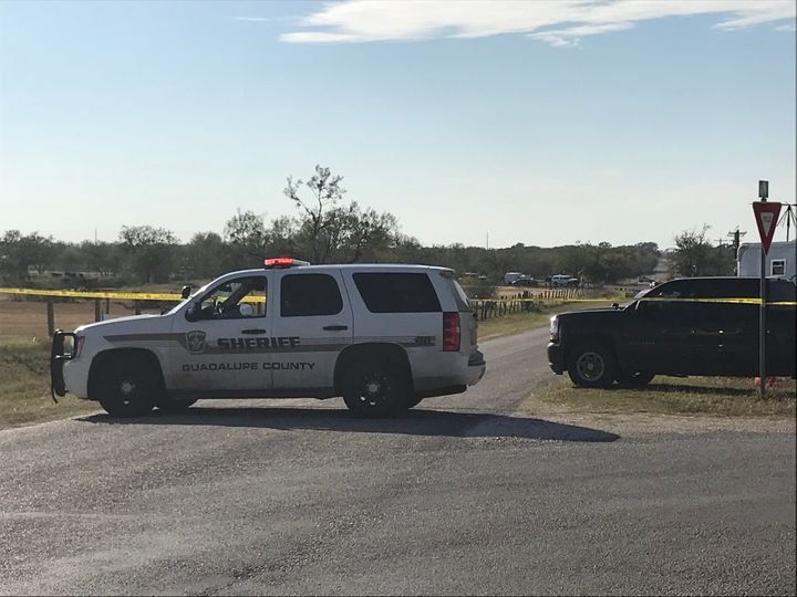 Police block a road in Sutherland Springs, Texas, after a gunman shot dozens of people at a nearby church on Sunday. Sut