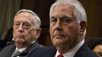 Rex Tillerson, U.S. Secretary of State, right, and Jim Mattis, U.S. Secretary of Defense, listen during a Senate Foreign Relations Committee hearing in Washington, D.C., U.S., on Monday, Oct. 30, 2017. President Donald Trump's secretaries of state and defense told Congress that Trump has all the authority he needs to fight terrorism with U.S. forces from Niger to Syria, after lawmakers from both parties raised concern about the extent of military deployments. Photographer: Zach Gibson/Bloomberg via Getty Images