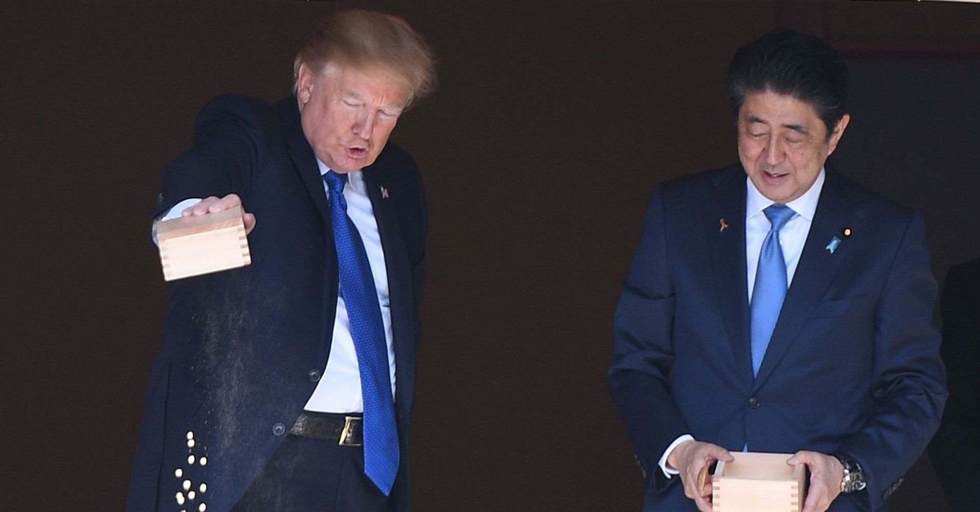 Watch as trump and japanese leader totally give up on for Trump feeding fish