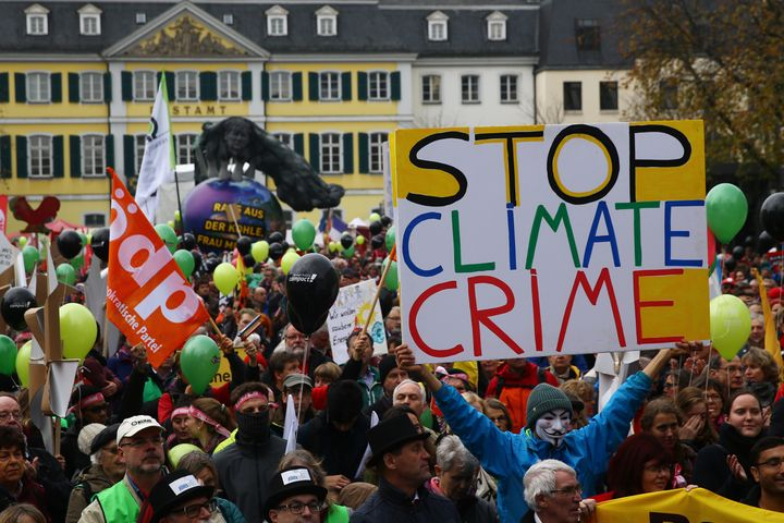 People march during a demonstration two days before the start of the COP 23 UN Climate Change Conferencein Bonn, German
