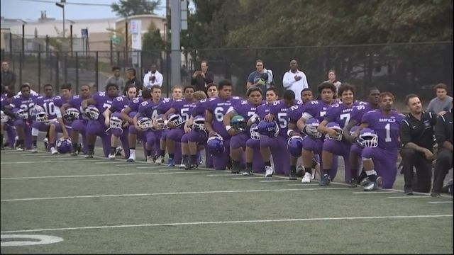 The entire Garfield High School football team knelt during the national anthem protesting social injustice.