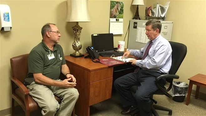 Dr. Michael Wilkerson discusses a patient's case with a nurse at a Bradford Health Services addiction treatment facility in W