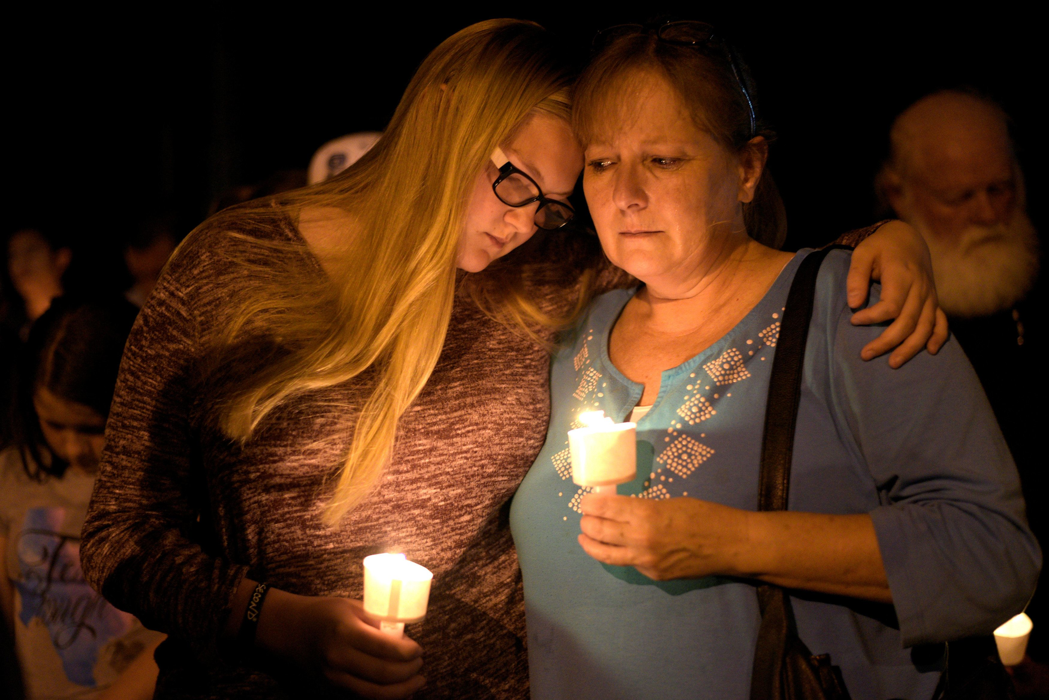 Terri and Brooke Kalinec attend a candle light vigil after a mass shooting at the First Baptist Church in Sutherland Springs, Texas, U.S., November 5, 2017.   REUTERS/Sergio Flores