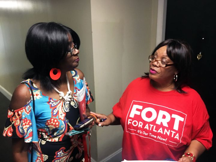 Deborah Arnold (right), a Fort campaign volunteer, speaks with Shelby Porter while canvassing the mixed-income City Views hig