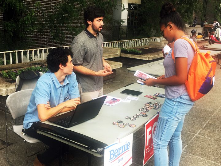 Jonathan Bo-o (left) and Matthew Golden (center) talk to a fellow student at Georgia State University about Fort's mayoral bi