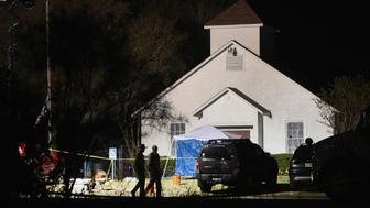 SUTHERLAND SPRINGS, TX - NOVEMBER 06:  Law enforcement officials continue their investigation at First Baptist Church of Sutherland Springs during the early morning hours of November 6, 2017 in Sutherland Springs, Texas. Yesterday a gunman, Devin Patrick Kelly, killed 26 people at the church and wounded many more when he opened fire during a Sunday service.  (Photo by Scott Olson/Getty Images)