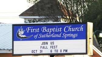 A sign at the First Baptist Church, where a gunman entered a church and began firing guns, resulting in many fatalities and injuries, displays worship schedule in Sutherland Springs, Texas, U.S., November 5, 2017.   REUTERS/Joe Mitchell