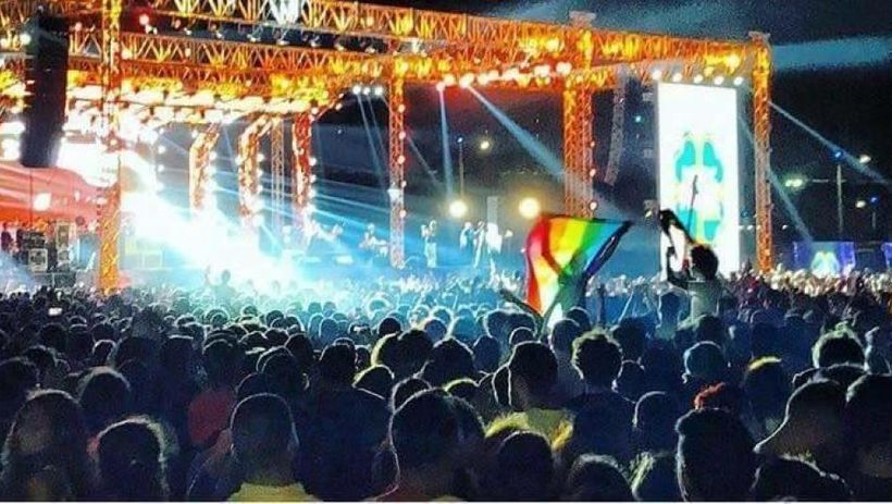 Young people wave a rainbow flag at a Cairo concert featuring the Lebanese band Mashrou' Leila. Activist Ahmed Alaa confirmed