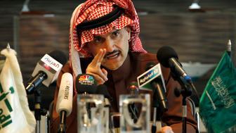 Saudi Prince Alwaleed bin Talal speaks during a news conference in Riyadh March 9, 2011. Saudi billionaire Prince Alwaleed bin Talal threw his weight behind Saudi stocks on Wednesday, saying he would invest 1 billion riyals ($267 million) in a market pummelled by unrest in the Arab world.       REUTERS/Fahad Shadeed  (SAUDI ARABIA - Tags: POLITICS BUSINESS)