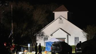 SUTHERLAND SPRINGS, TX - NOVEMBER 06:  Law enforcement officials continue their investigation at First Baptist Church of Sutherland Springs during the early morning hours of November 6, 2017 in Sutherland Springs, Texas. Yesterday a gunman, Devin Patrick Kelley, killed 26 people at the church and wounded many more when he opened fire during a Sunday service.  (Photo by Scott Olson/Getty Images)