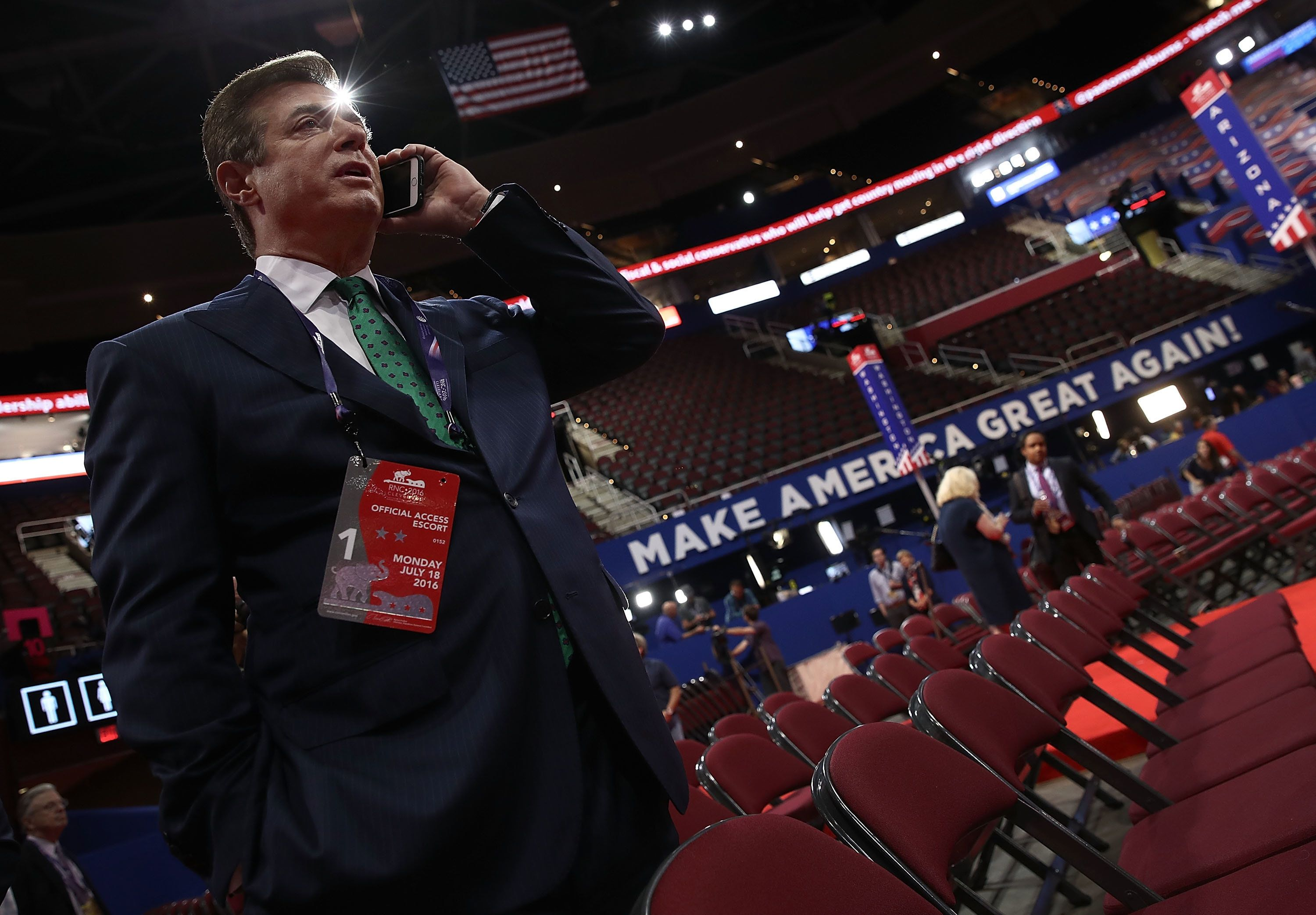 CLEVELAND, OH - JULY 17:  Paul Manafort, Campaign Manager for Donald Trump, speaks on the phone while touring the floor of the Republican National Convention at the Quicken Loans Arena as final preparations continue July 17, 2016 in Cleveland, Ohio. The Republican National Convention begins tomorrow.  (Photo by Win McNamee/Getty Images)