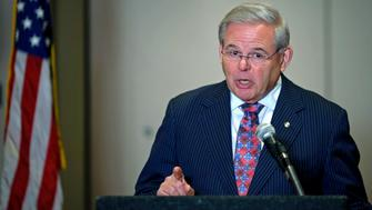 "U.S. Senator Bob Menendez speaks during a news conference at Newark, New Jersey March 6, 2015. Menendez of New Jersey said on Friday he was ""not going anywhere"" after CNN reported the Justice Department is preparing criminal corruption charges against him.   REUTERS/Eduardo Munoz (UNITED STATES - Tags: CRIME LAW)"