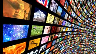 A vast wall of television/computer screens showing a wide variety of images stretching to infinity against a black background