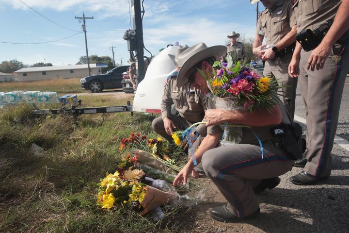 Police move flowers placed at a barricade near the First Baptist Church of Sutherland Springs on Monday. Gunman Devin Patrick
