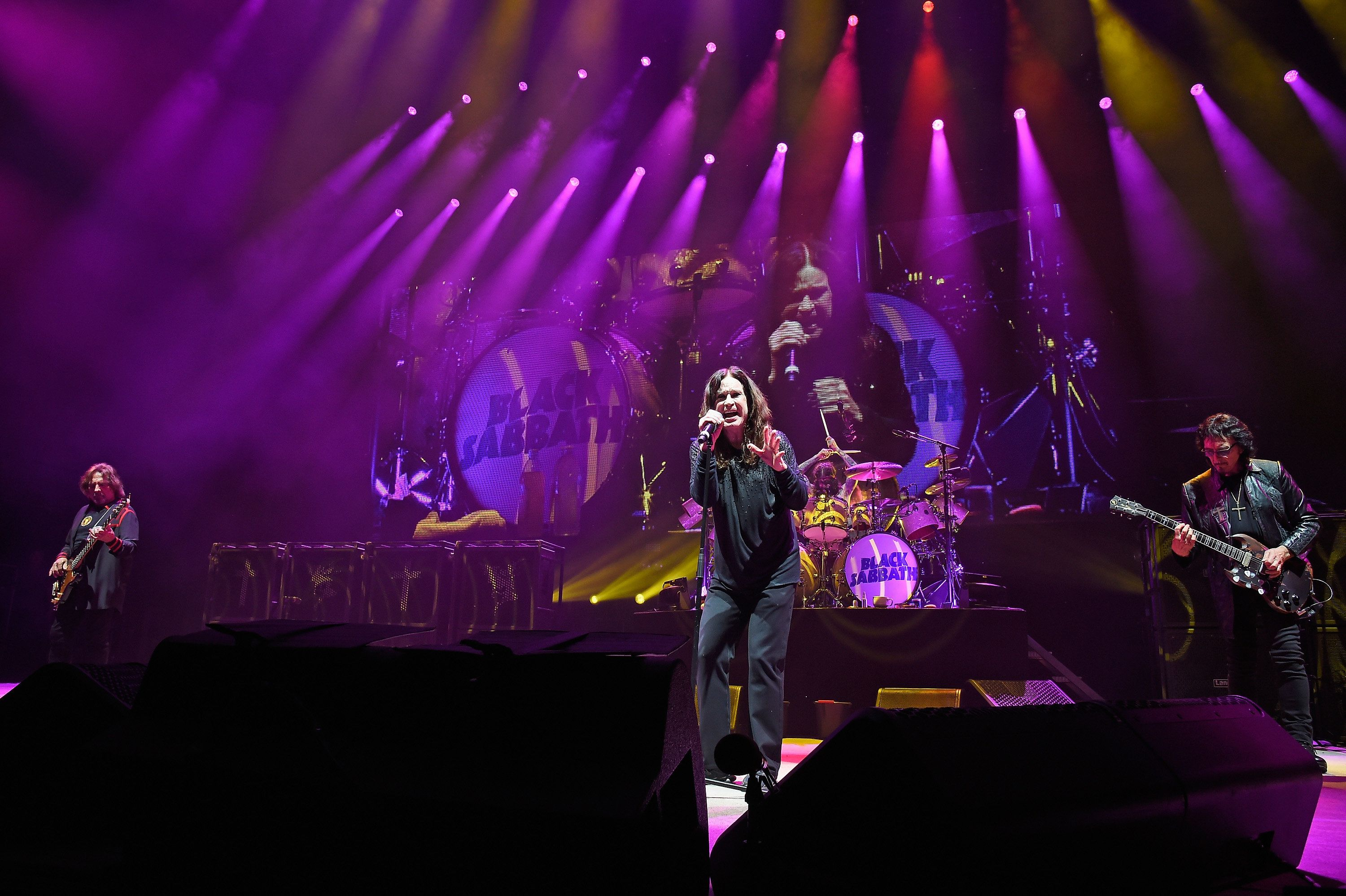 WANTAGH, NY - AUGUST 17:  (L-R) Geezer Butler, Ozzy Osbourne, Tommy Clufetos, and Tony Iommi perform onstage as Black Sabbath on 'The End Tour' at Nikon at Jones Beach Theater on August 17, 2016 in Wantagh, New York.  (Photo by Kevin Mazur/WireImage)