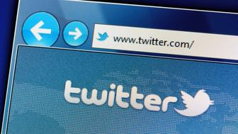 'Muenster, Germany - May 23, 2011: The twitter website is displayed in web browser on a computer screen. Twitter is a social networking and microblogging service and enabling its users to send and read messages.'