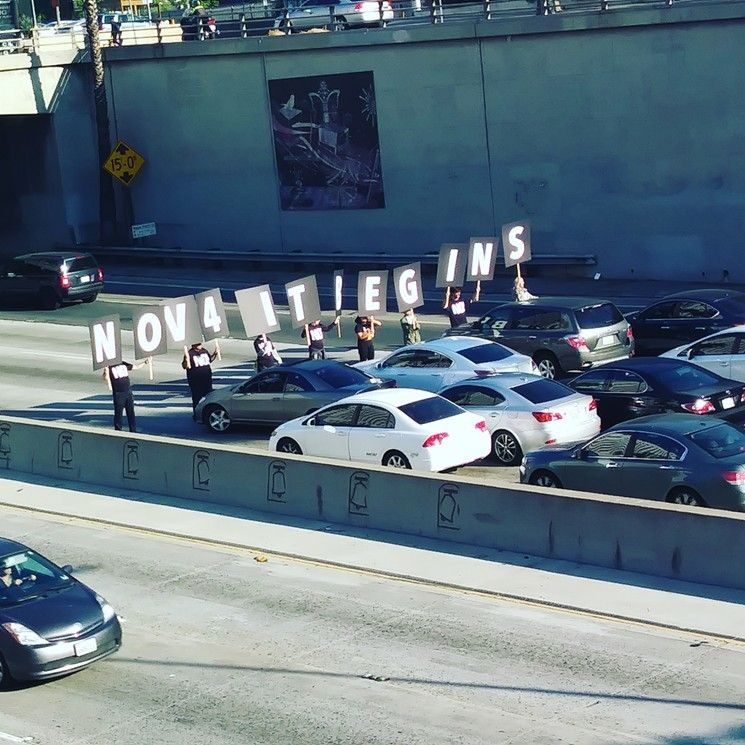 Anti-Trump protesters blocked the four northbound lanes of the 101 Freeway during rush hour on Sept. 26.