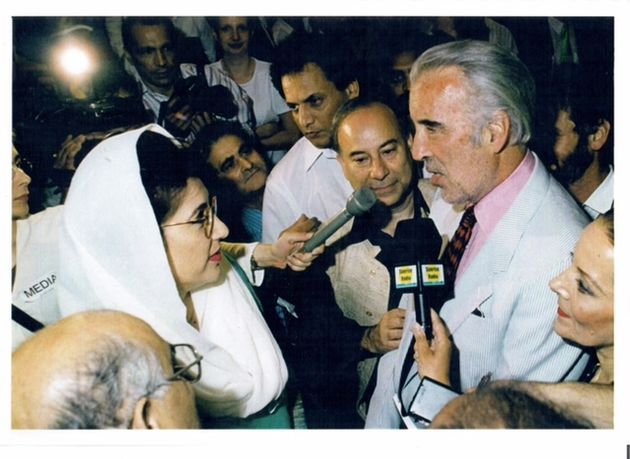 Akbar Ahmed is joined by Prime Minister Benazir Bhutto and Sir Christopher Lee in 1997 for the launch...