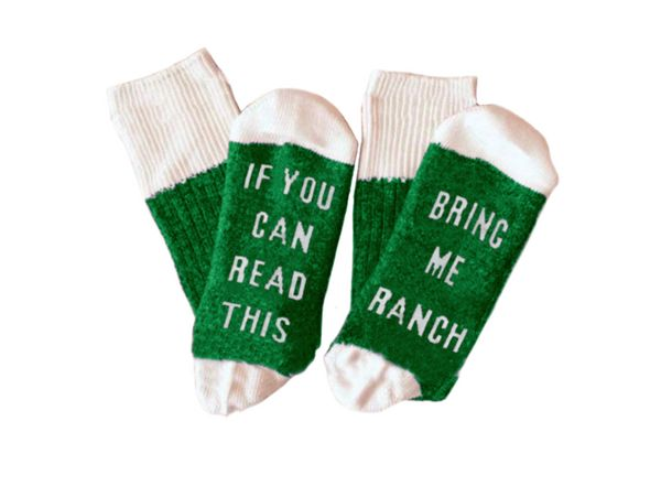 "Buy the <a href=""https://www.flavourgallery.com/collections/hidden-valley-ranch/products/hidden-valley-ranch-statement-socks"""