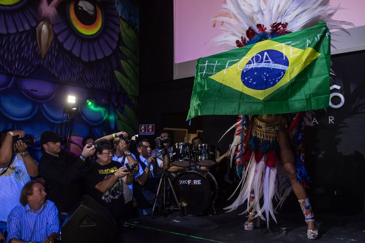 Rosie Oliveira from Amazonas holds a Brazilian national flag with an inscription reading 'Temer out' (a reference to Brazilia
