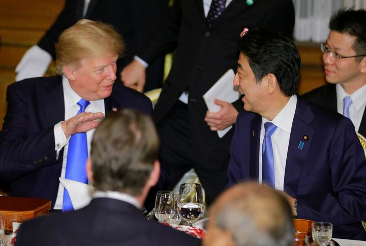 U.S. President Donald Trump talks with Japanese Prime Minister Shinzo Abe at a welcome dinner at Tokyo's Akasaka Palace on Nov. 6, 2017.