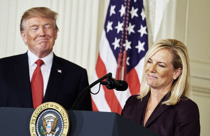 President Donald Trump stands beside Kirstjen Nielsen, his nominee for homeland security secretary.