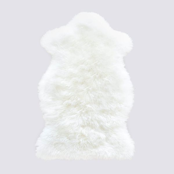 "This all natural, ethically sourced <a href=""https://www.the-citizenry.com/collections/best-sellers/products/sheepskin-throw"""