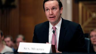 Senator Chris Murphy (D-CT) introduces Dr. Scott Gottlieb before a Senate Health Education Labor and Pension Committee confirmation hearing on his nomination to be commissioner of the Food and Drug Administration on Capitol Hill in Washington, D.C., U.S., April 5, 2017. REUTERS/Aaron P. Bernstein