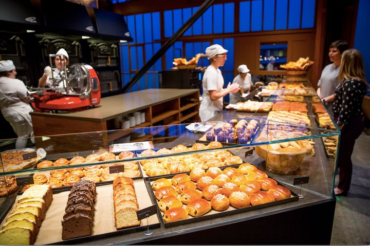 At Princi, food is baked fresh onsite in a giant central oven.