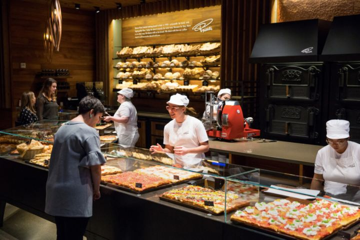 Visitors shop a range of fresh-baked goods at Princi, the new Starbucks-owned bakery and cafe in Seattle.