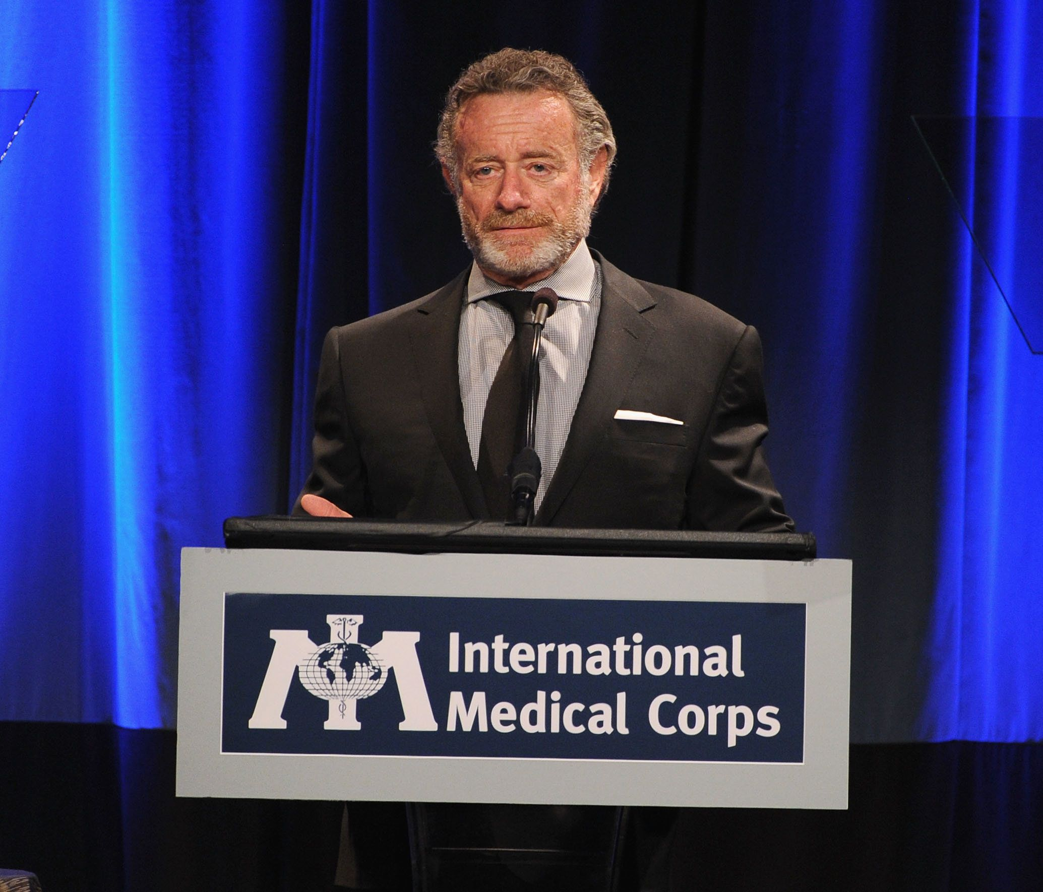 BEVERLY HILLS, CA - NOVEMBER 08:  Master of Ceremonies Jarl Mohn speaks onstage at the International Medical Corps Annual Awards Celebration at Regent Beverly Wilshire Hotel on November 8, 2013 in Beverly Hills, California.  (Photo by Kevin Winter/Getty Images for International Medical Corps)