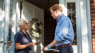 BLACKSBURG, VA - JULY : Chris Hurst, Democratic candidate for the VA House of Delegates, speaks with Sue Elliott, left, while canvassing a neighborhood in his district on Tuesday, July18, 2017 in Blacksburg, Va.  (Jay Westcott/For The Washington Post via Getty Images)