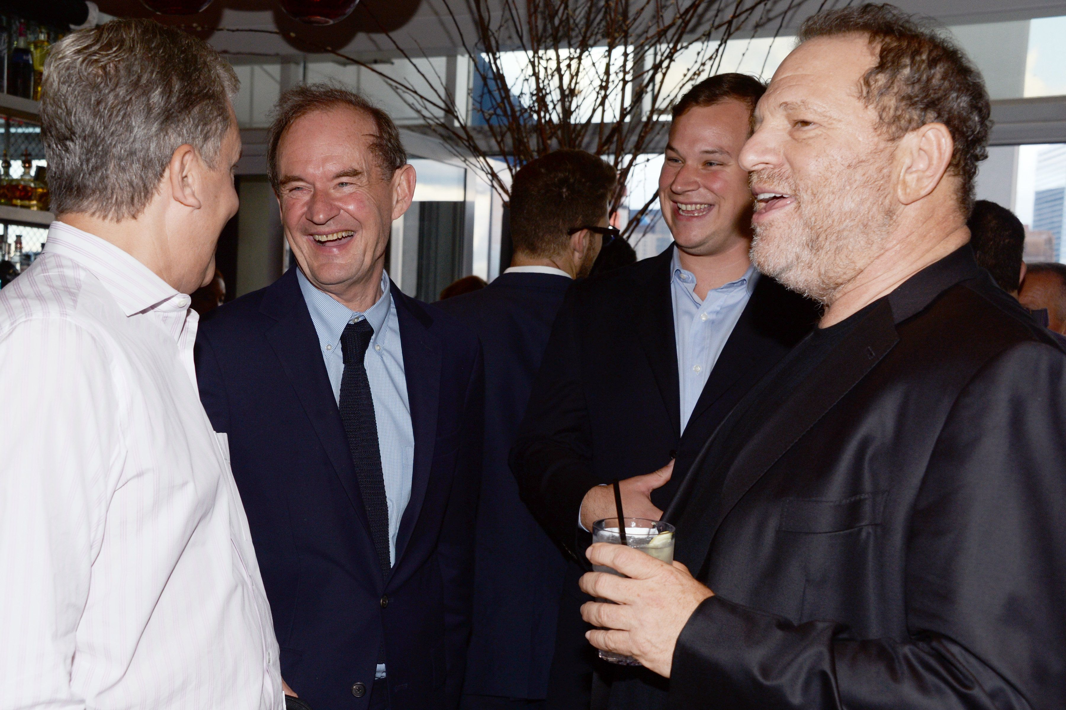New York Times publisher Arthur Sulzberger, left, lawyer David Boies, a guest and studio executive Harvey Weinstein attend a