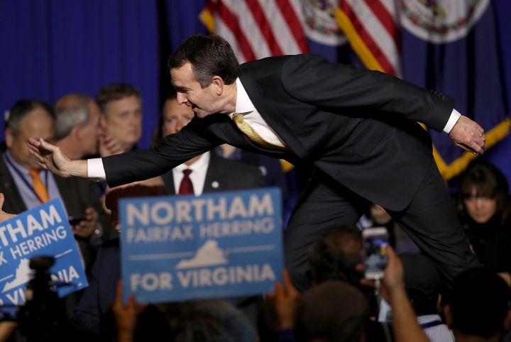 Democrat Ralph Northam celebrates his victory over Ed Gillespie to be governor of Virginia.
