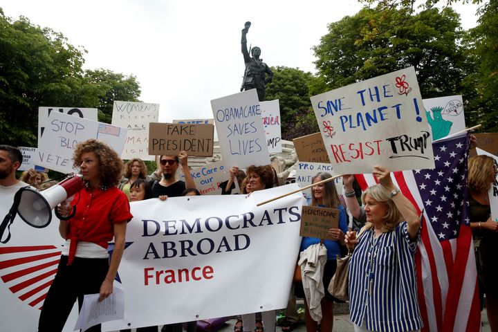 People gather to protest the visit of U.S. President Donald Trump in Paris on July 13, 2017.