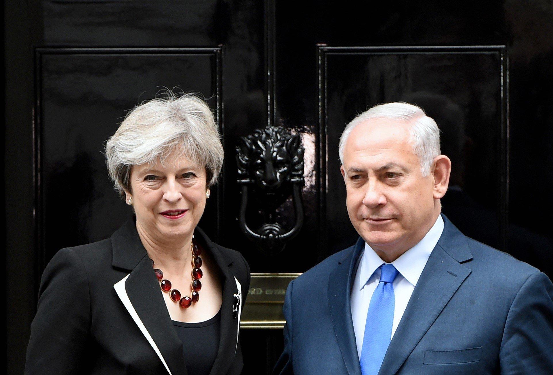 Theresa May greetsIsraeli Prime Minister Benjamin Netanyahu. She did not know at the time that Priti Patel has also met him.