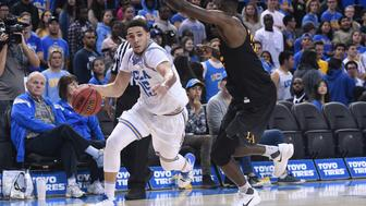 LOS ANGELES, CA - NOVEMBER 01: UCLA guard LiAngelo Ball (15) drives to the basket during an college exhibition basketball game between the Cal State Los Angeles and the UCLA Bruins on November 1, 2017, at Pauley Pavilion in Los Angeles, CA. (Photo by Brian Rothmuller/Icon Sportswire via Getty Images)