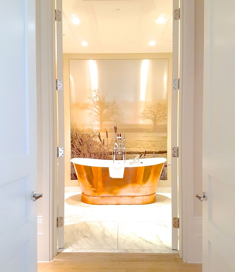 Impossibly deep copper bathtub in the ultra-luxe suite bathrooms with heated floors and Mitchell and Peach toiletries