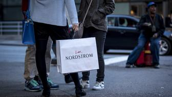 A woman carries a Nordstrom Inc. shopping bag in Chicago, Illinois, U.S., on Sunday, Nov. 6, 2016. Nordstrom is scheduled to release earnings figures on November 10. Photographer: Christopher Dilts/Bloomberg via Getty Images