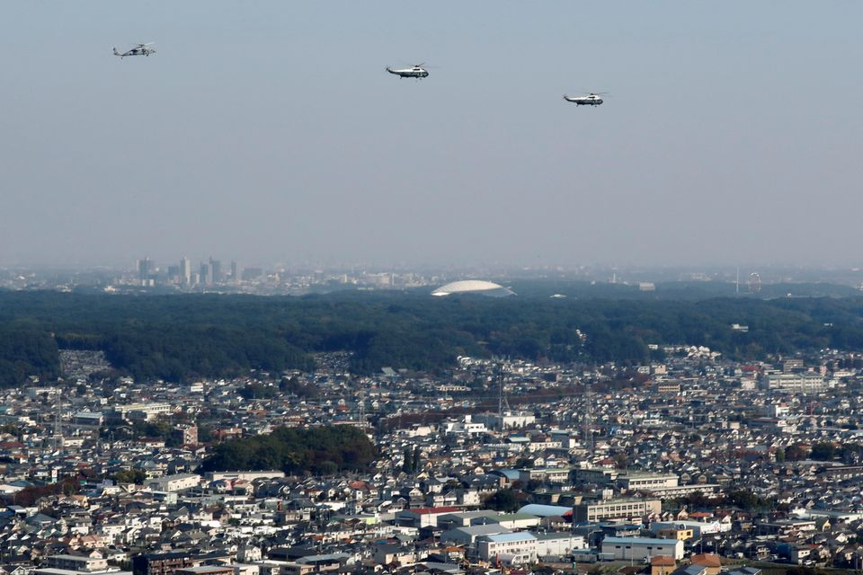 U.S. President Donald Trump flies via Marine One helicopter over the Tokyo suburbs to meet Japan's Prime Minister Shinzo Abe