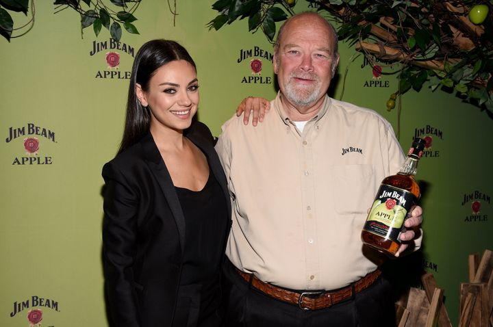 Mila Kunis pictured with Fred Noe, seventh generation Jim Beam Master Distiller, at a Jim Beam Apple launch event on Oct. 20, 2015 in New York City.