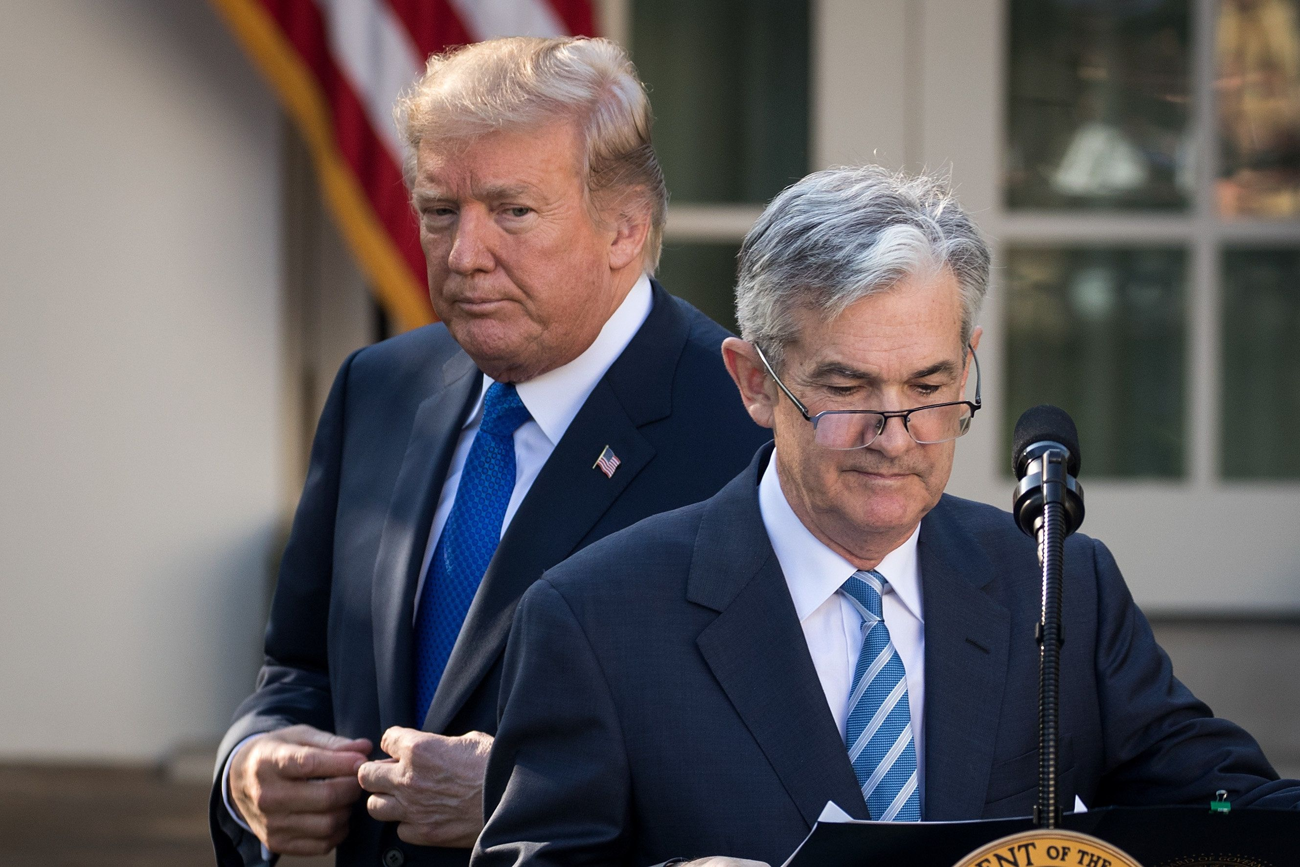 President Donald Trump looks on as his nominee for the chairman of the Federal Reserve Jerome Powell takes to the podium in t