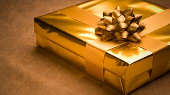 Golden christmas gift on horizontal composition