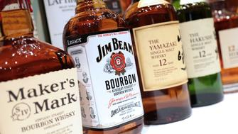 Bottles of Beam Suntory Inc. spirits including Maker's Mark, front left to right, Jim Beam, Yamazaki and Hakushu stand on display at a news conference in Tokyo, Japan, on Thursday, May 15, 2014. Suntory Holdings Ltd., the closely held Japanese whiskey and beer maker, this January agreed to buy Beam Inc. for $16 billion including debt to gain brands such as Maker's Mark whiskey and create the world's third-largest premium spirits company. Photographer: Yuriko Nakao/Bloomberg via Getty Images