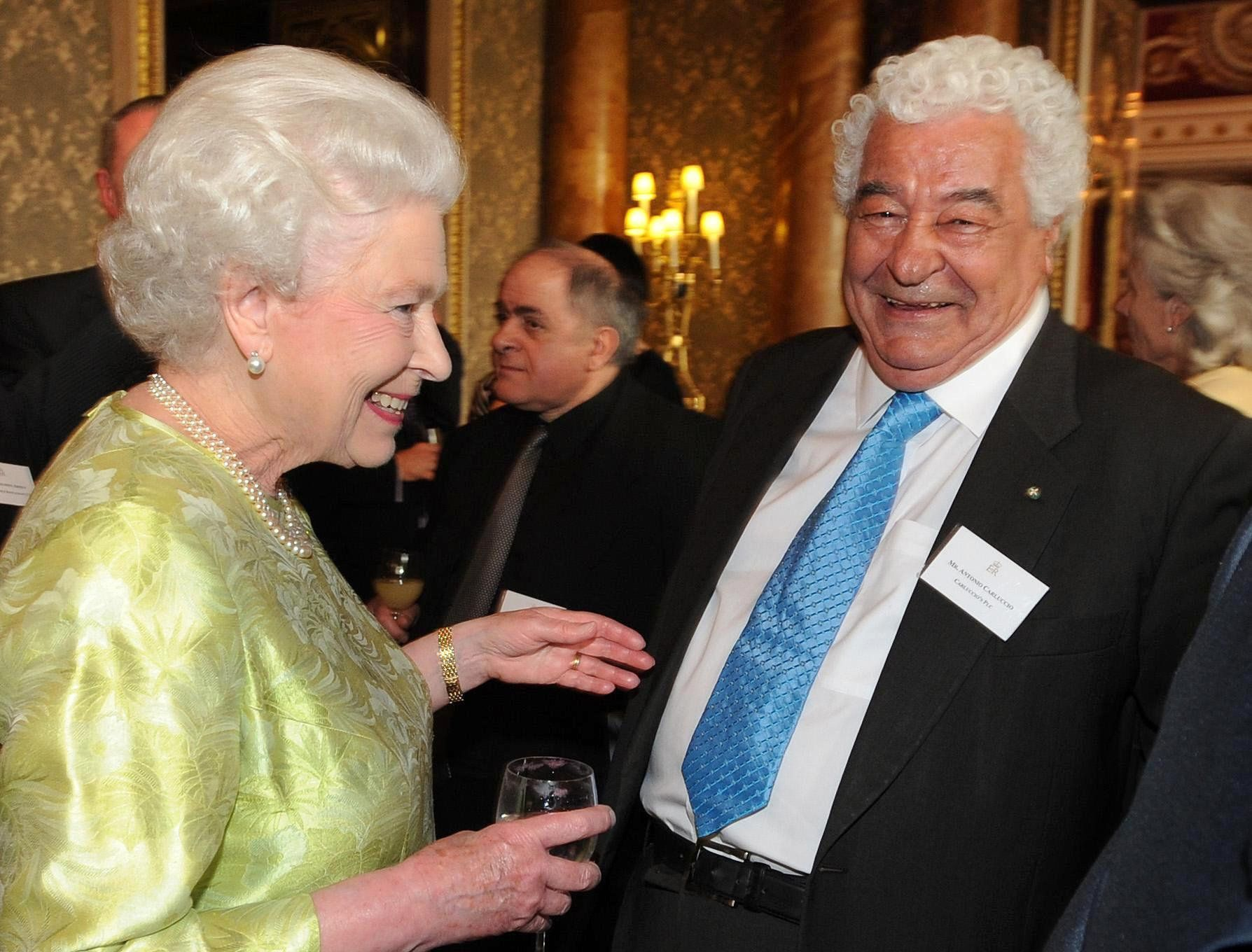 <strong>Carluccio pictured with the Queen during a reception she hosted for the British Hospitality Industry at Buckingham Palace&nbsp;</strong>