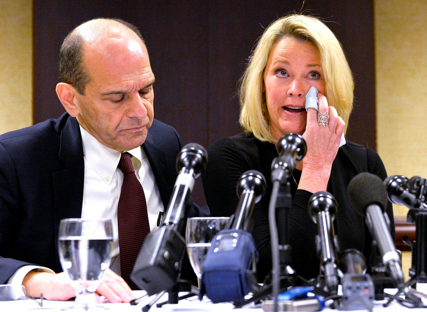 Former Boston news anchor Heather Unruh sits with her attorney Mitchell Garabedian at a press conference in Boston November 8