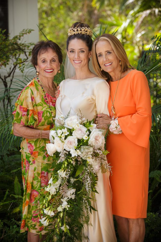 Bride Pilar posing with her grandma Anita and her mother